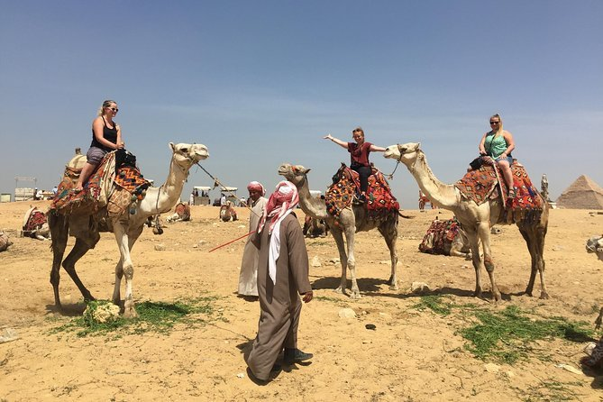 Private Half-Day Trip to Giza Pyramids, Sphinx, Workers Tombs with Camel Ride Preview Image