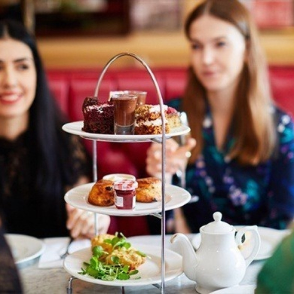 Waitress and free afternoon tea with a glass of prosecco at Cafe Rouge Images